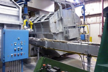 Melting and continuous casting section in an aluminium slug plant